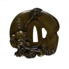 Tsuba with a Monkey Teasing an Elephant with a Stick